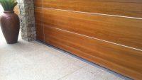 Residential stainless steel linear drain heelguard outside garage